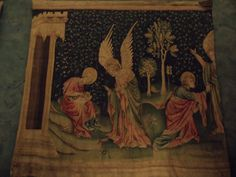 Tapestry of the Apocalypse Scene from The Whore of Babylon, representation of chapter 17 of the Apocalypse of St. John. The angel shows the whore to St. John. Gothic art. Tapestry.