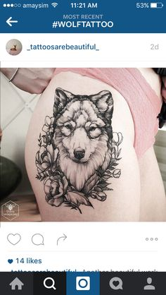 Wolf and flower tattoo