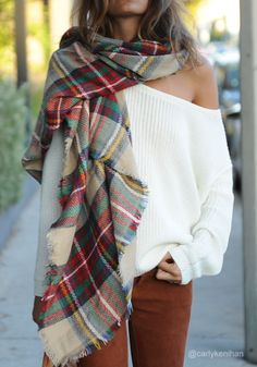 carlykenihan is wearing lookbookstore warm tartan plaid shawl. A good hug is all it takes to ease the sadness away. And a stylish wrap, like this tartan plaid shawl, is all it takes to make the chill disappear.