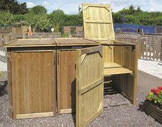 Our Wheelie Bin Storage Shed is made from Jakcure treated softwood, tongue and groove effect boards and has an internal galvanized steel frame for extra strength. It looks great in the garden and is perfect for hiding bins. Triple Wheelie Bin Storage, Bin Store Garden, Garden Bike Storage, Hide Trash Cans, Jacksons Fencing, Shed Design Plans, Covered Garden, Storage Bins, Storage Solutions