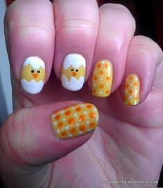Nail art design of Orange and white dots on yellow base with chicks accent nails
