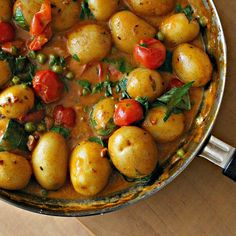 coconut potato curry with basil. Jenn's notes: Use any kind of potatoes- cut into chunks if preffered. Extra basil suggested.