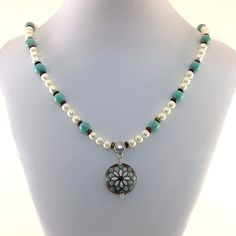 I made this gorgeous brown and turquoise stoneware necklace using a pretty Golem design studio lentil bead as a focal. I added silver beads, wire