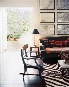 John Dransfield & Geoffrey Ross - A seating arrangement with a zebra-print rug