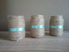 Glass baby food jars have been turned into the perfect wedding centerpiece decor - wrapped with jute twine and a delicate Robins Egg blue ribbon. So many uses for this jar! Place a lighted tea-light for a soft glow. Or place a few small flowers inside and use as a vase. Coordinates perfectly with Burlap and Lace decor. Also available are many other coordinating pieces - painted tin cans, small glass jars, large mason jars, and lots of other wedding decor. Please browse my shop for the…