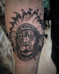 Black and grey Indian headdress lion tattoo