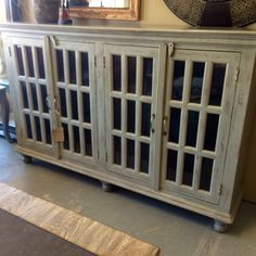 Beautiful pale gray distressed finish on this sideboard.
