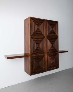Custom-made wall-hung storage cabinet in jacaranda with lattice front. Designed by Joaquim Tenreiro (1906-1992), Brazil, circa 1955.