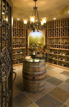 Decorating. Good Looking Diy Wine Cellar Decoration Ideas. Attractive Diy Wine Cellar Decoration Inspiration With Oak Wood Material Wine Cellar Style Modern And Brown And Gray Tile Floor Plus Wooden Drum Table With Round Glass Top Along With Dark Gray Iron Door As Well As Classic Chandelier Lamp