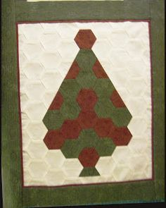 """A Christmas Tree wall hanging designed and made by Cathi  which measures approximately 18.5 x 22 inches.  Collection:  the 1.25"""" hexagon col..."""