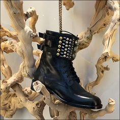 Goth Boots are not normally associated with the great outdoors, except if trees and natural branches are as eerie as these. Too knobby and knurled for Walking Sticks or even hand carved Burl Smokin… Goth Boots, Walking Sticks, Visual Merchandising, Branches, Hand Carved, Combat Boots, Trees, Carving, Retail