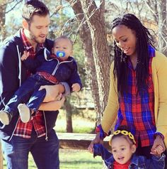 Interracial couple with biracial children.