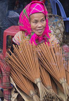 Incense vendor . Bac Ha market . Vietnam