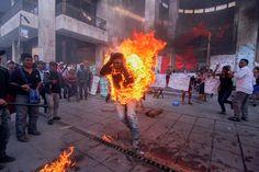 Farmer Agustin Gomez Perez, 21, was lit on fire as a form of protest outside the Chiapas state legislature in Tuxtla Gutierrez, Mexico on Dec. 5, 2014. AP PHOTO/CUARTOSCURO, JACOB GARCIA