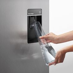 Fisher and Paykel fridges have a slimline water dispenser that allows you to fill your vessels with ease.  See all Bob Miller's Fisher and Paykel fridge inventory here: http://www.bobmillers.com/appliances/refrigeration/refrigerators/bottom-freezer-refrigerator.html?manufacturer=13
