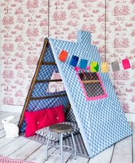 Bright pattern tent from a drying rack - fabulous indoor camp party idea or playroom fun!