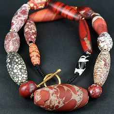 Ancient jasper & a rare fossil coral bead in this weaved knot worked necklace.  http://www.ancient-beadart.com/descriptions.php?id=pc2
