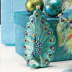 Glass Proud Peacock Ornament                              …