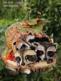 Raccoons in the old stump by Galina Maslikhina