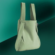 notabag | olive  The Cool Green bag (and backpack!). 💚 Ever been out shopping and then had your hands full? Perhaps on a bike - or just too many things to carry?  Notabag is a smart combination of a bag and a backpack. With a single pull on the straps, it transforms itself from a sleek eco-friendly bag to an easy-to-carry backpack.  @thenotabag #green #re-use #environment #sustainability #design