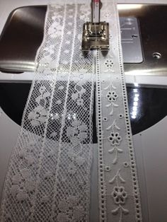 I have been making a fancy band with French cotton lace.      Now I'm adding a row of Swiss cotton lace with entredeux.It is attached using...