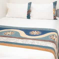 Duvet Covers ~ Mali Designs Double $240.00 USD Duvet cover and pillowcases in 100% cotton material, inlaid with beautiful hand-painted fabric strip with an authentic African motif design, depicting circles and traditional emblems, in a maritime azure colourway. #Mali #TribalTextiles