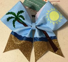 Bows by April - The Beach Full Glitter Cheer bow, $23.00 (http://www.bowsbyapril.com/the-beach-full-glitter-cheer-bow/)