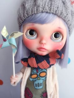 She looks so sad. A lot of Blythe dolls have very human, almost plantive
