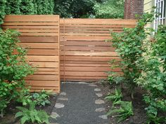Staggered horizontal fence for back yard driveway privacy, or way around fencing regulations for side/front yard?