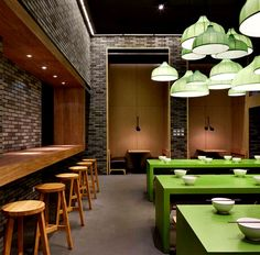 Asian #Restaurant with Fresh Green Elements - exposed #brickwalls noodle house #decor