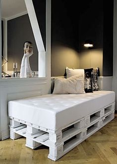 Use pallets and pads to create seating that can double as a guest bed~!