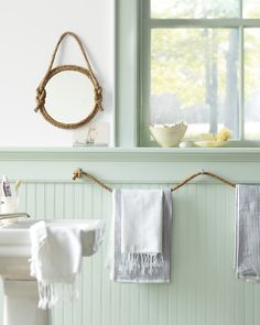 i LOVE this, rope to hang towels and wrap rope around a mirror for accent....LOVE!