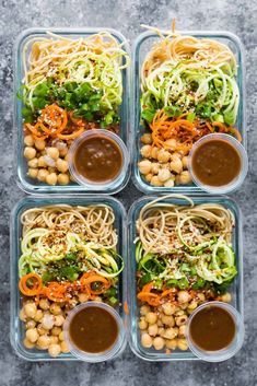 cold sesame noodle vegan meal prep bowls: spiralized vegetables with chickpeas + whole wheat spaghetti in spicy almond butter sauce.