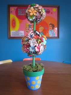 Use all that jewlery that you don't use anymore or find at consignment shops and make great centerpieces for your house