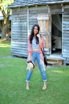 A floral fringed kimono and high waist boyfriend jeans