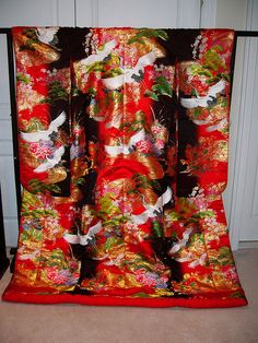 Wedding kimono    Woven wedding kimono (uchikake) with the popular crane motif as well as pine trees and flowers.