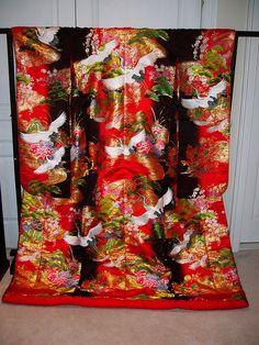 Wedding kimono    Woven wedding kimono (uchikake) with the popular crane motif as well as pine trees and flowers.