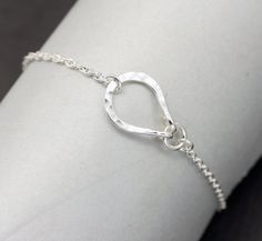 Handcrafted with nickel free sterling silver this unique bracelet features a hand forged and hammered center piece inspired by the shape of a