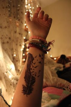 feather bird tattoo