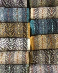 This stack of scarves by Sarah Tyssen is everything I love about fall weaving ~ @sarahtyssen
