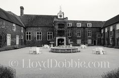 Black and white image of the courtyard at Fulham Palace, by Lloyd Dobbie