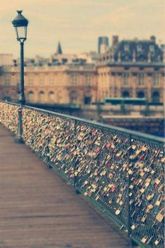Love Lock Bridge, Paris France.   Here, lovers take a simple decorated padlock and lock it to the bridge fence. Once the lock is locked, the key is meant to be tossed into the river below.  So, no matter what the two go through, the lock is there as a reminder of their bond.