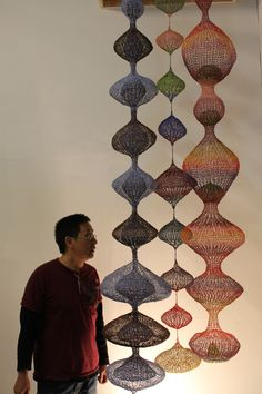 Tuan & Long Hanging Wire sculptures, made from recycled telephone wire. Color and texture vary!