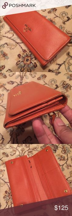 PRADA WALLET Bought here in Poshmark as well.. Price reflects on its usage. Edges has wears but zippers and snaps are all in good shape. Inclusion: Box, Authenticity Card  included. Ask questions.. Prada Bags Wallets