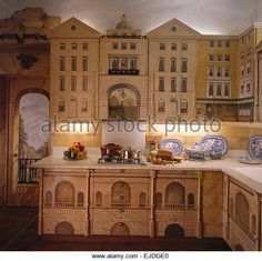 http://l7.alamy.com/zooms/1e27fe79aa174e87bb4277fc12989c6a/nineties-kitchen-with-cupboards-painted-with-a-trompe-loeil-georgian-ejdge0.jpg