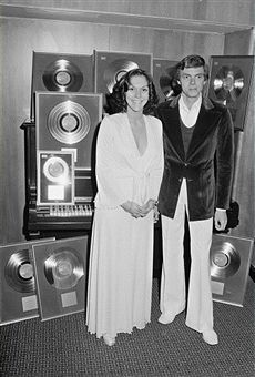 American pop duo The Carpenters, Karen Carpenter (1950 - 1983) and her brother Richard, with awards for sales of their albums, 22nd February 1974.