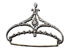 DIAMOND DIADEM c1895 .   The central diamond flowerhead suspended in an old European-cut diamond stylised navette-shaped surround to the scroll terminals and foliate border.  Accompanied by a necklace attachment and a red leather fitted case. (Christie's)