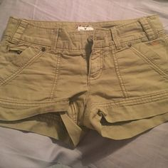American Eagle tan/light brown shorts American Eagle light brown denim shorts. 2 front and 2 back pockets. Buckle detail in the back, small zipper detail on front pocket that opens to a tiny pocket. Great condition American Eagle Outfitters Shorts Jean Shorts