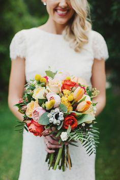 Cheery bouquet with pops of color: http://www.stylemepretty.com/2014/08/20/whimsical-country-wedding-in-australia/ | Photography: Jonathan Ong - http://www.jonathanong.com/