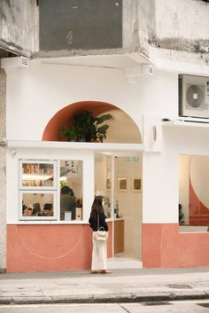 One of the semi-circular windows is recessed above the cafe's entrance, creating a sheltered, terracotta-coloured tunnel for housing potted plants. Hong Kong Cafe, Restaurants, Old Apartments, Terrazzo Flooring, Cafe Design, Bakery Design, Color Tile, Large Windows, Architectural Digest